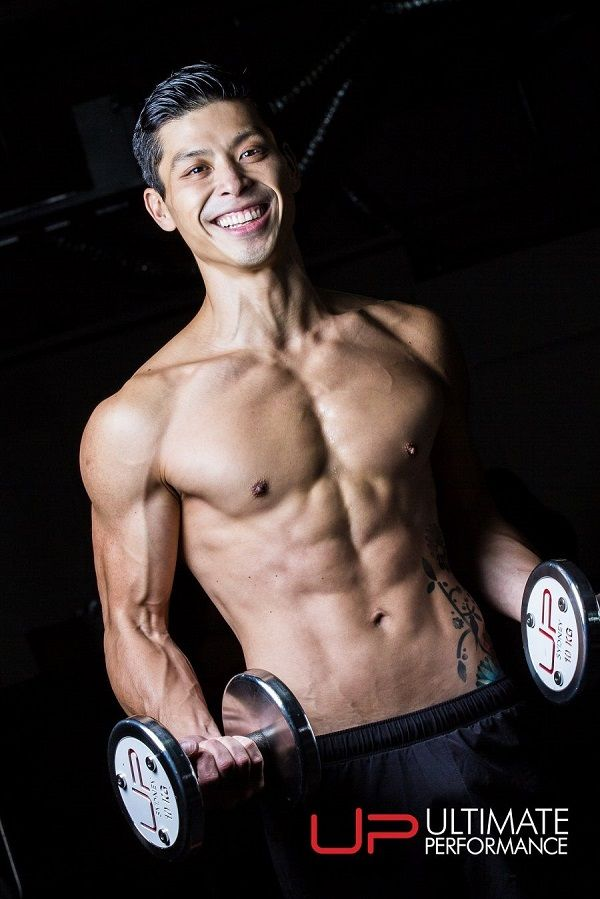 TIM Chinese man with muscle holding dumbbells