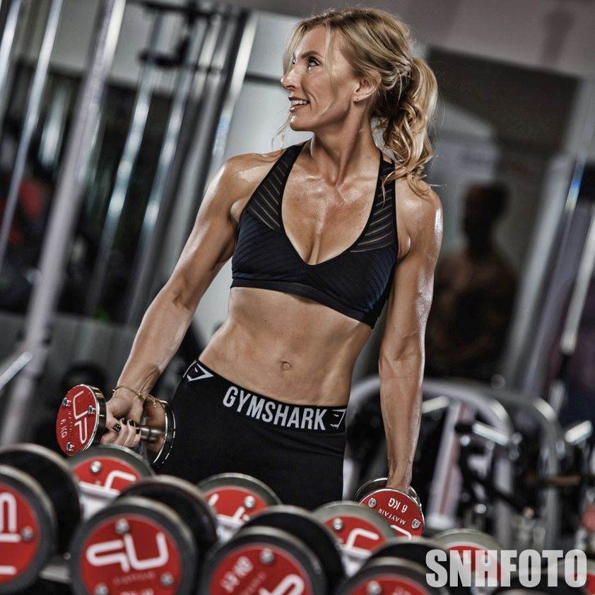 Joanne-in-the-gym-smiling-to-side-dumbbells-web