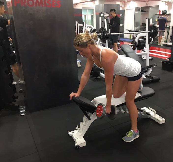 Female performing single dumbbell row