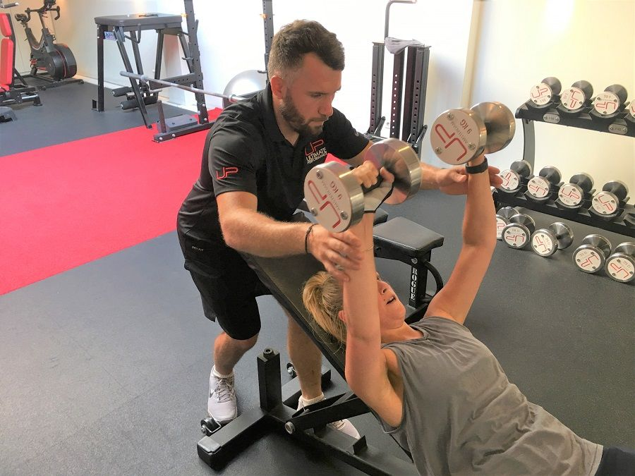 Estelle-in-the-gym-with-trainer-900-web