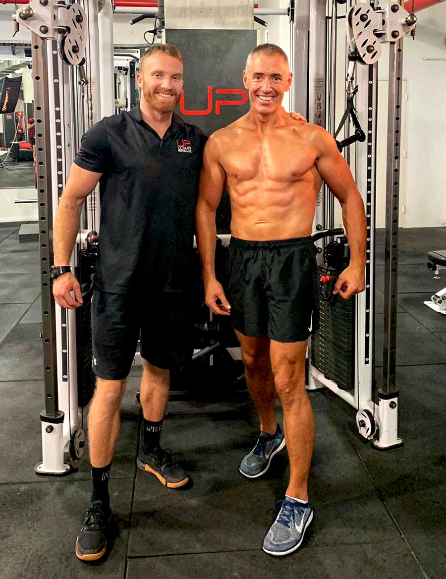Greville-in-the-gym-smile-with-trainer
